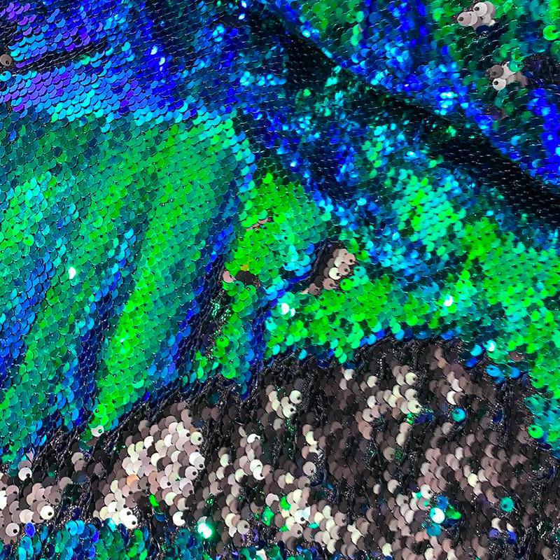 Tessuto al metro Paillettes Scrivente Verde-Blu